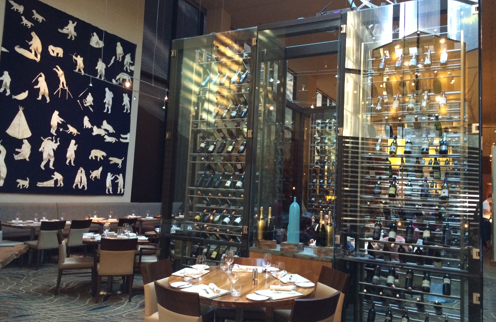A table is located within the glass Wine Room at YEW, for private-dining up to 10 people.