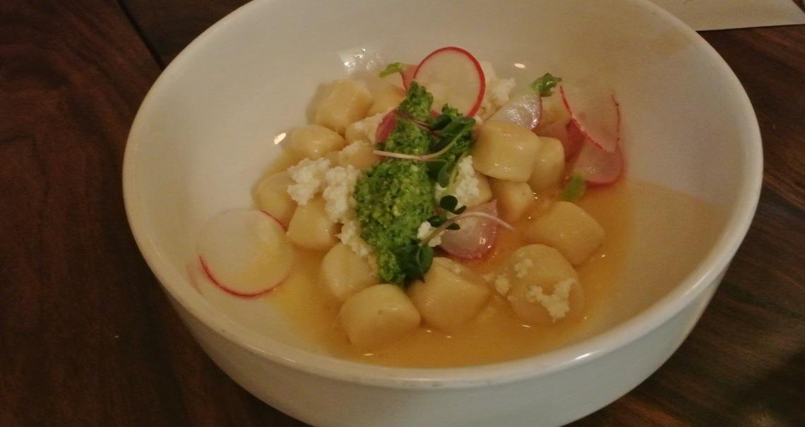 Parisienne gnocchi, radishes, radish green pistou, buttermilk ricotta.