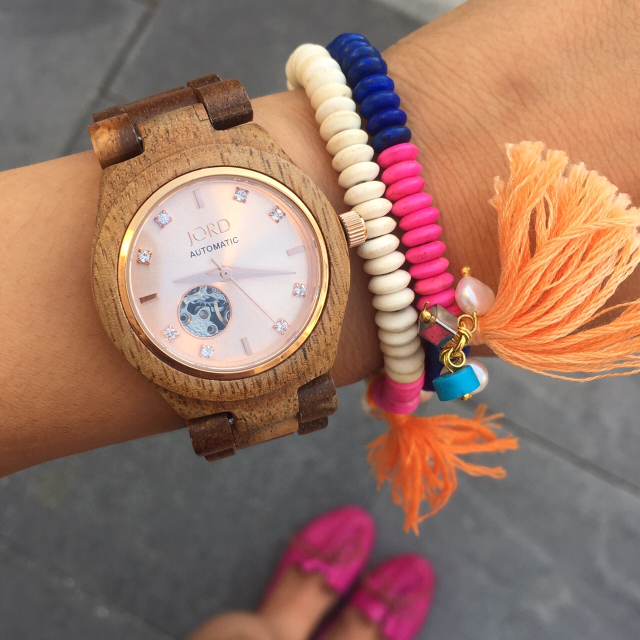 """Jord """"Cora"""" Watch in Koa & Rose Gold ($275) c/o WoodWatches.com / Alliyah Bracelet in Colbat and White ($10 each) c/o Ardillas United / The """"April"""" Flat in Fuxia ($125) c/o MizMooz"""