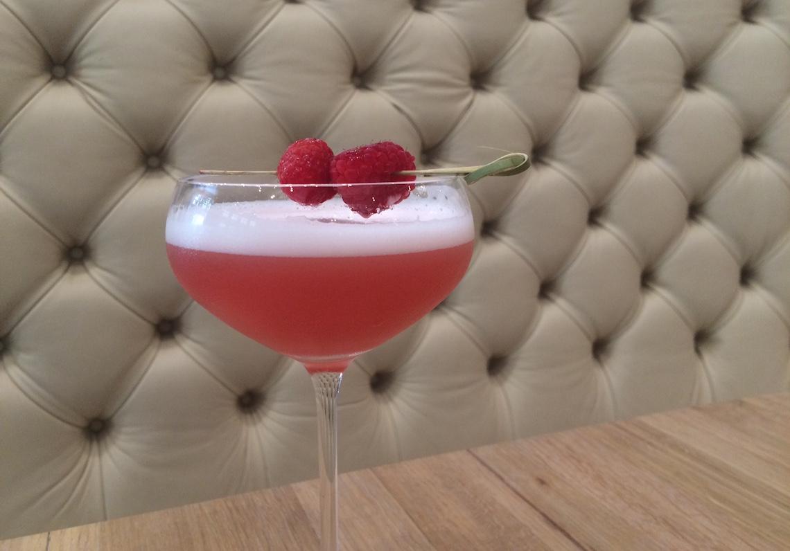 The Cypress Cocktail (Non-Spirited) with Mountain Berry Tea, Lemon, Honey, Egg whites and Raspberries.