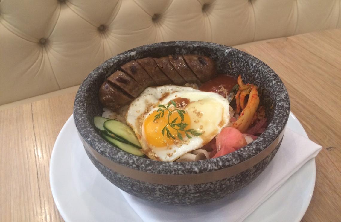 Korean Rice Bowl ($22) with Snake River Farm Wagyu Galbi Sauage, Kimchi, Free-Range Sunny Side Up Eggs, Sesame Dressing.