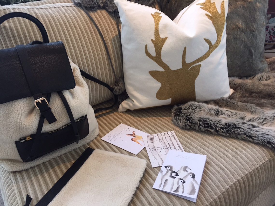 Indigo Holiday 2015: Faux Shearling Backpack ($69.50) / 18 x 18 Gold Deer Pillow Cover ($39.50)