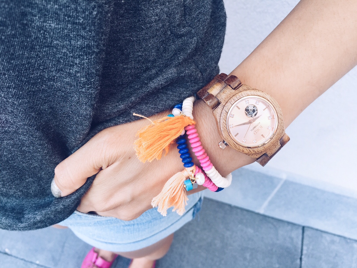"Jord ""Cora"" Watch in Koa & Rose Gold ($275) c/o WoodWatches.com / Alliyah Bracelet in Colbat and White ($10 each) c/o Ardillas United"