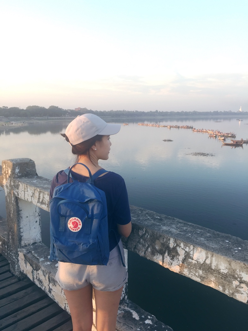 On Ubein Bridge, looking out over Taungthaman Lake, wearing a Fjallraven Kanken Backpack in Lake Blue