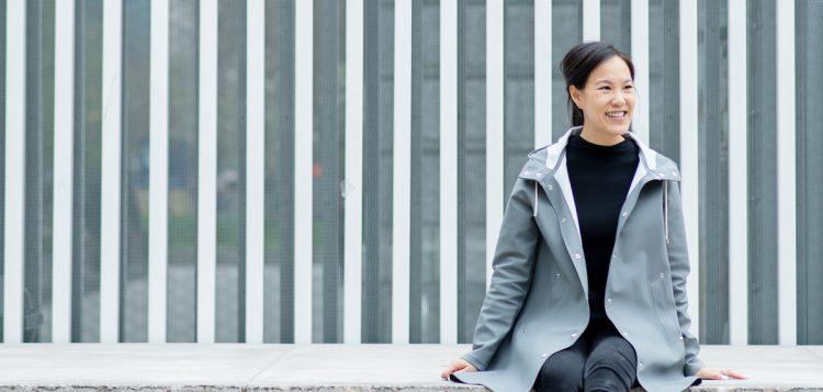 Girl wearing Stutterheim Grey Raincoat