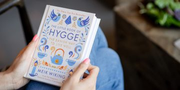 Holding Hardcover Book in Hands The Little Book of Hygge