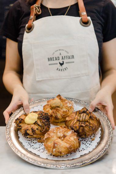 Four Kouign Amann Pastries on a platter at A Bread Affair