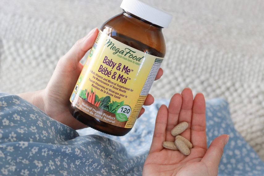 Holding a jar of Baby and Me Prental Supplement